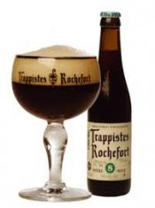 darkred rochefort beer in a glass with aside the bottle