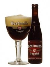 westmalle double beer glass with dar brown trappist and bottle
